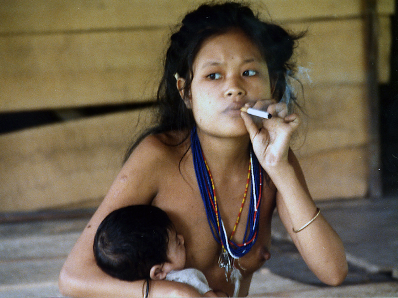 Smoking and breast feeds her baby