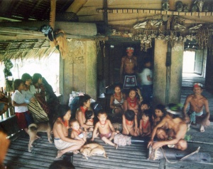 Extended family inside their Uma on the Rereiket River near Matatonan