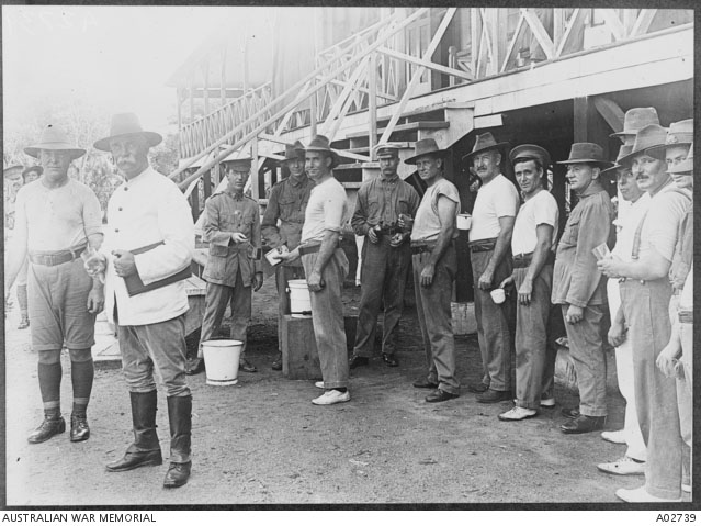 Men line up for their dose of quinine.