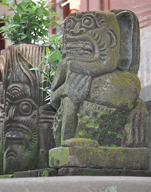 Carvings by the entrance to the late Wayan Cemul's compound.