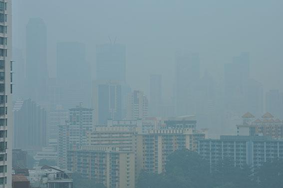 Smoke haze from peat fires in Sumatra, Singapore October 1, 2015.