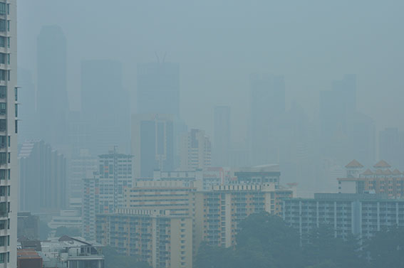 Smoke haze from peat fires in Sumatra, Singapore October 1, 2015.